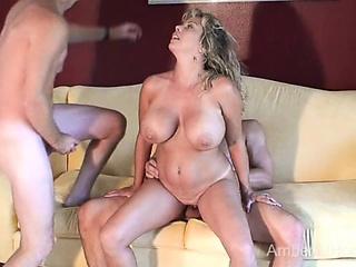 Hot swinger MILF sucks together with fucks 2 guys