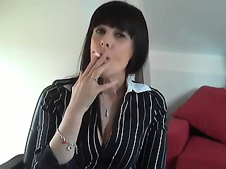 Dark-haired mature babe is agog to give excuses you hard wits smokin