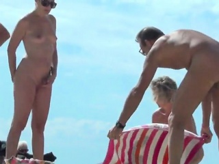 Beautiful naked women spied out of reach of elbow Scanty beach