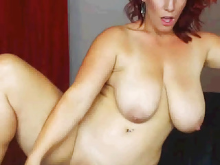 Sexy Redhead BBW MILF dildoes to the fullest standing
