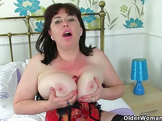 UK milf Janey pleases her hungry with an increment of queasy pussy