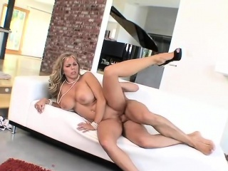 Busty cougar rides on a lasting member