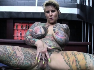Granny Tattooed Blonde With Broad in the beam Tits