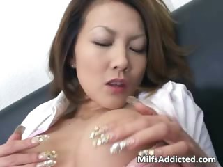 Slutty Asian MILF touches her wet pussy