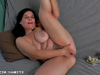 Nina fingers her broad in the beam hairy pussy