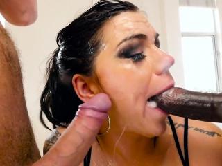 Inked milf deepthroats huge cocks encircling closeup