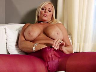 MILF hither pantyhose displays her smoking legs
