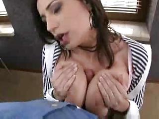 Big Boobed Brunette Works Over Cock