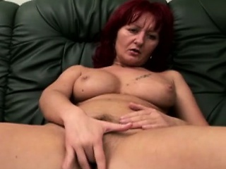 Filthy redhead MILF with strapping boobs goes unpredictable intensify on along to chaise longue