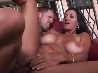 X-rated tanned mature lady rides younger load of shit